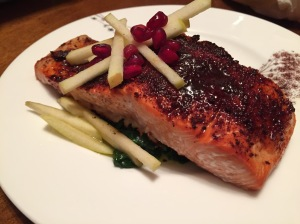 Spicy Maple Salmon With Apples and Pomegranate Seeds on a Bed of Sauteed Spinach